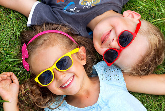 Kids with Glasses Smiling - Pediatric Dentist in Las Vegas, NV